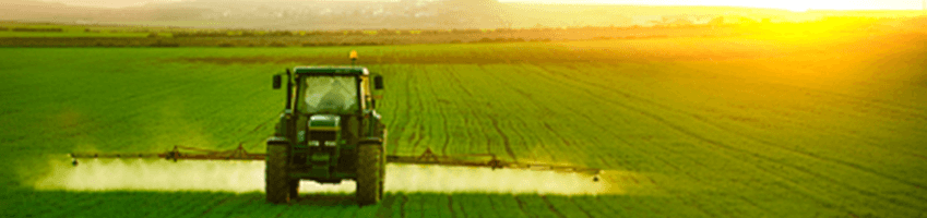 A farm tractor moving through a field.