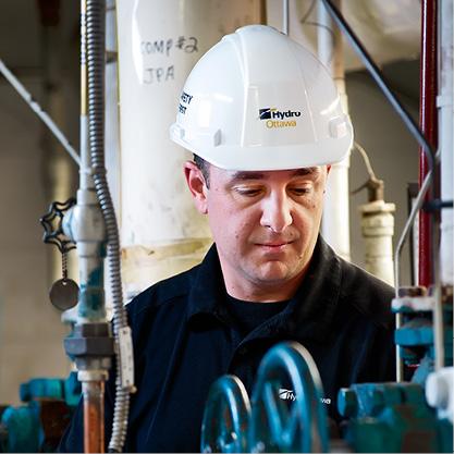 Hydro Ottawa employee inspecting equipment