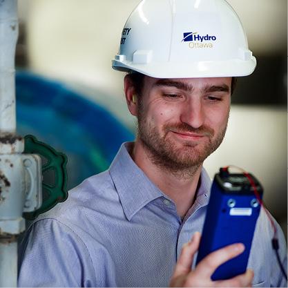 Hydro Ottawa Employee reading a data meter