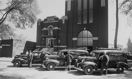 Proudly displaying our new fleet vehicles at King Edward Hydro Terminal Station, Ottawa circa 1945.