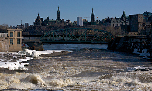 A present day view of Parliament Hill from the Chaudière Falls generating station on the Ottawa River.