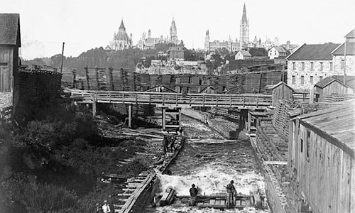 View from the Chaudière Falls generating station (to the right) on the Ottawa River. Parliament looks majestic in the distance. Below, workers harness the power of the Ottawa River at the turn of the century.