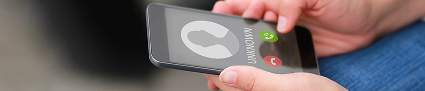 Mobile phone screen receiving a call from an unknown number