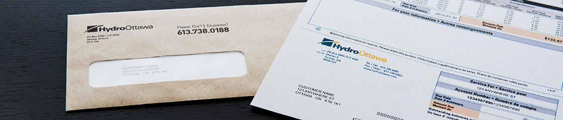 A Hydro Ottawa electricity bill and addressed outside mailing envelope