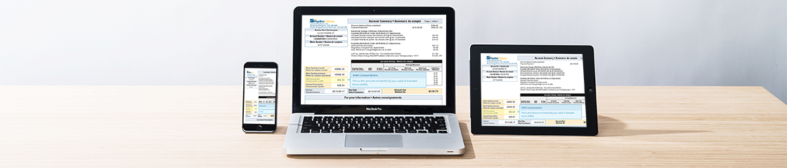An iPhone, Macbook and iPad on a table showing an interactive Hydro Ottawa bill.
